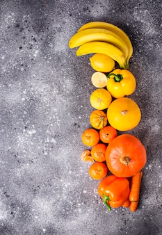Assortment of yellow and orange fruits and vegetables
