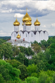 Assumption cathedral golden domes, with green trees and grey clouds background, yaroslavl, russia