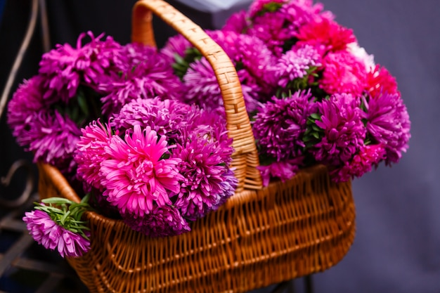 Aster flowers bouquet purple red pink white on a wood