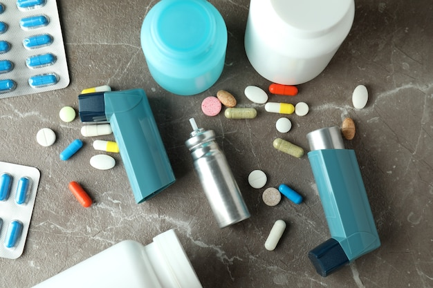 Asthma treatment accessories on gray textured table