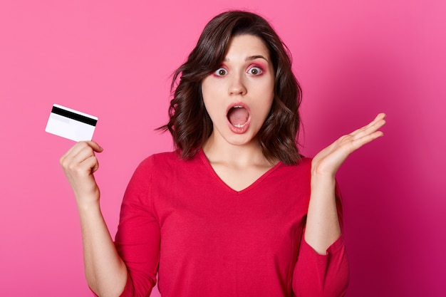 Astonished brunette woman being short of money, has no opportunity to make purchase online