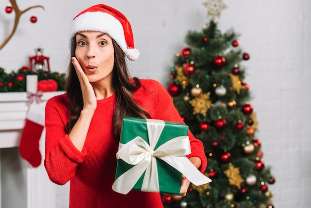 Astonished female with green gift box