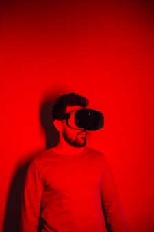Astonished man in vr goggles