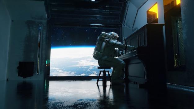 宇宙服を着た宇宙飛行士は、惑星地球空間を見下ろす宇宙船でピアノを弾きます