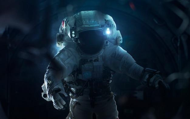 Астронавт и инопланетянин. контакт. элементы этого изображения, предоставленные наса