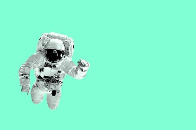 Astronaut flies over aqua menthe color trend