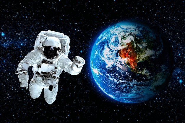 Astronaut flies over the earth in space