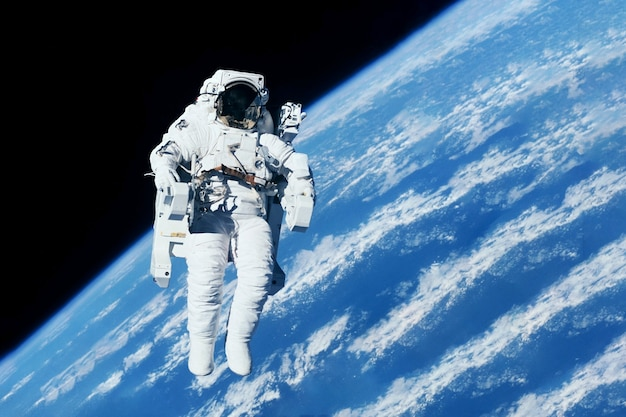 Astronaut above the ground in outer space elements of this image were furnished by nasa