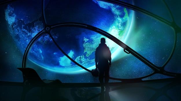 Астронавт смотрит на землю