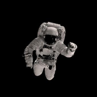 黒の背景に宇宙飛行士。 nasaによって提供されたこの画像の要素
