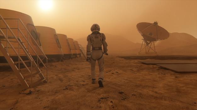 Астронавт на планете марс делает объезд своей базы. астронавт идет по базе.