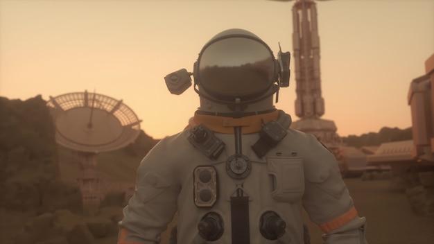 火星の表面の宇宙飛行士。火星の植民地化の概念。 3dレンダリング