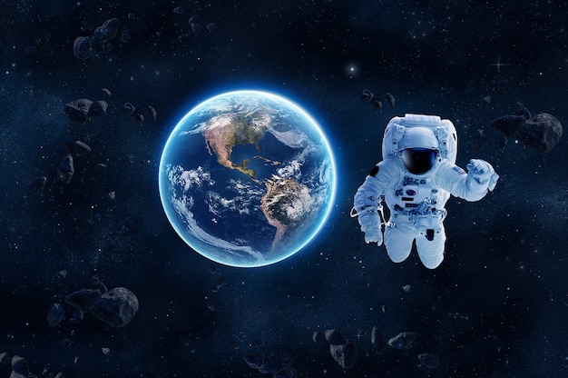 Astronaut in outer space over of the nightly earth  3d rendering