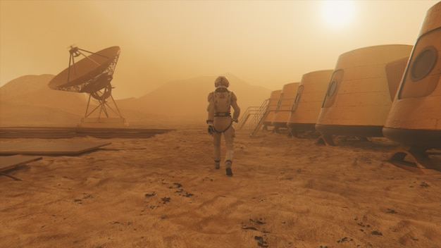 Astronaut on the planet mars, making a detour around his base. astronaut walking along the base.