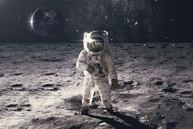 Astronaut on rock surface with space background