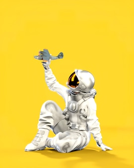 Astronaut sitting on the ground holds small airplane in hand, yellow background. 3d illustration