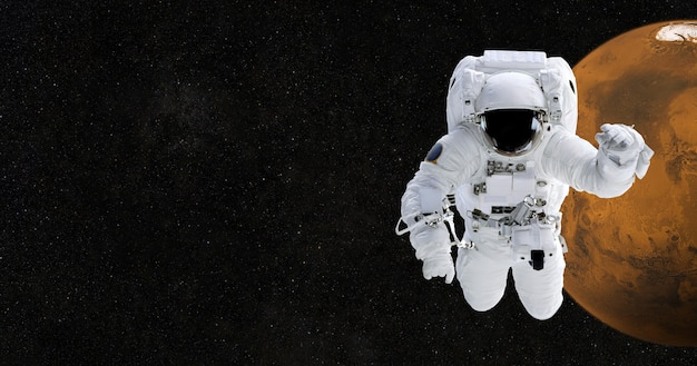 Astronaut in space against the planet mars