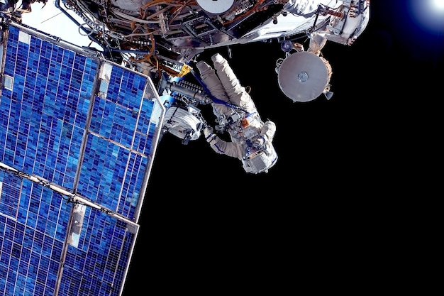 Astronaut at the space station is engaged in repairs elements of this image were furnished by nasa