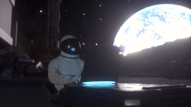 Astronaut works on his science laptop in a space colony on one of the planets. 3d rendering.
