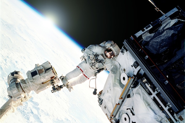 Astronauts on an orbiting space stationelements of this image furnished by nasa d illustration