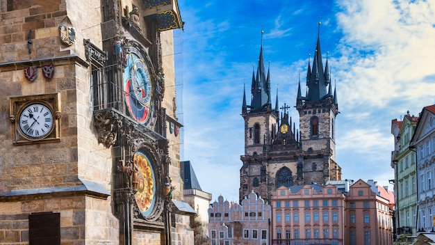 Astronomical clock in the old square of prague with the church of the virgin mary of tyn