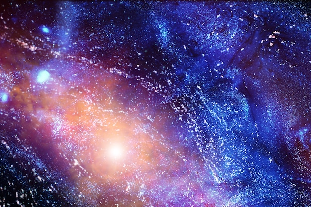 星雲と星のある遠方の銀河の宇宙の天文写真