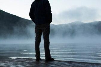 At a foggy lake