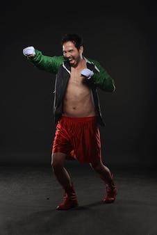 Athlete asian man boxer practicing punching