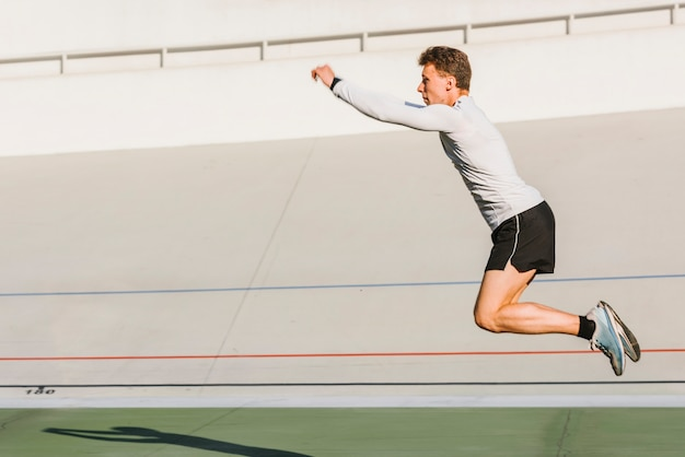 Athlete doing a long jump with copy space