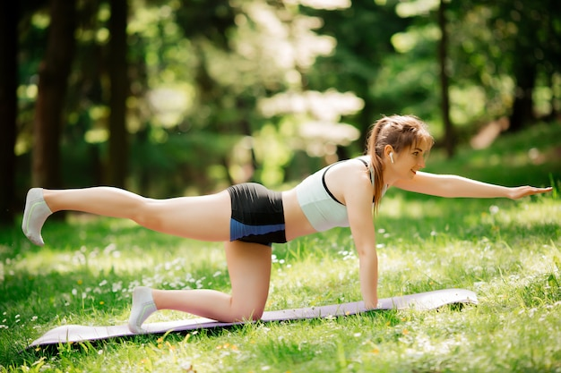Athlete doing warm-up outdoors sports concept women