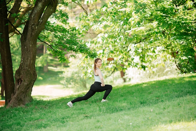 Athlete doing warm-up outdoors. sports concept. women