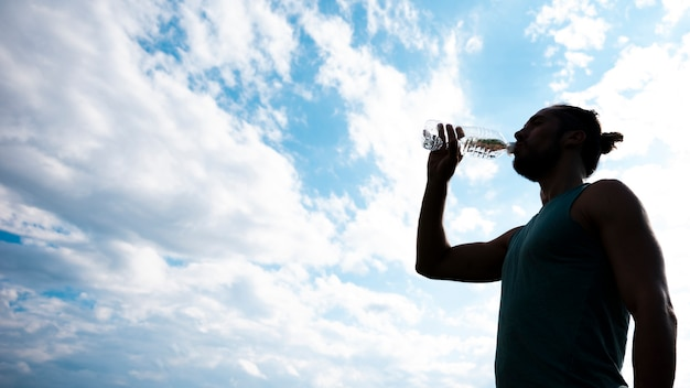 Athlete drinking water with copy space