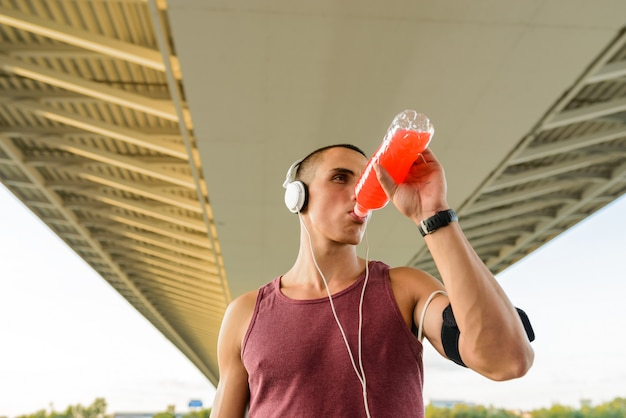 The athlete drinks water