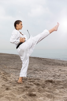 Athlete female training in karate outfit