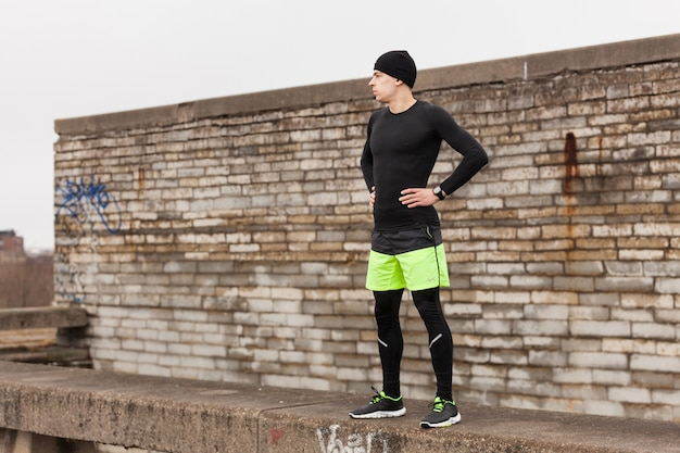 Athlete in front of a wall