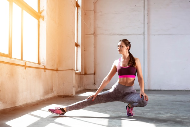 Athlete girl stretching hamstrings photo of a young girl exercising sports