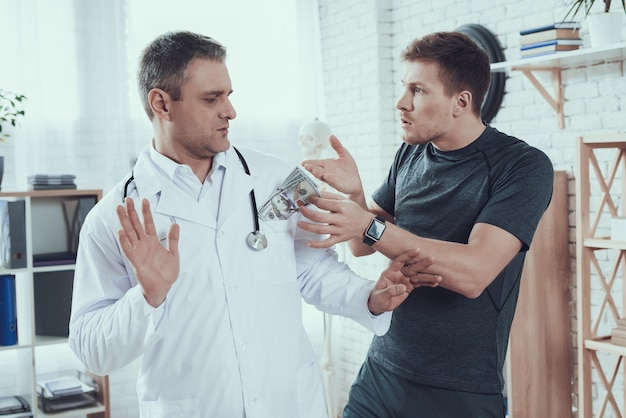 Athlete gives money to doctors man is refusing