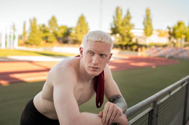 Athlete man resting on running track