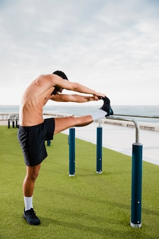 Athlete man warms up before workout