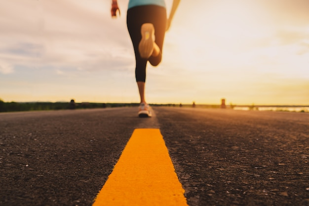 Athlete running on the road trail in sunset training. motion blur of woman exercising outdoors