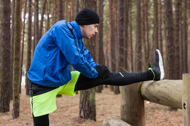 Athlete stretching in woods