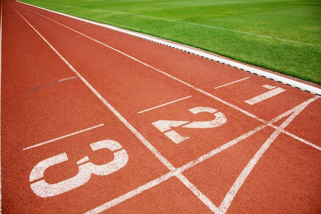 Athlete track or running track with three numbers lanes and lawn