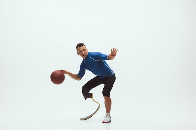 Athlete with disabilities or amputee on white studio background, basketball