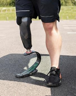 Athlete with prosthetic leg close up