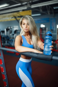 Athlete with a water bottle in the gym