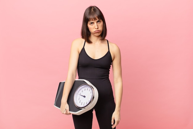 Athlete woman feeling sad and whiney with an unhappy look, crying with a negative and frustrated attitude