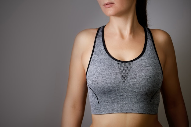 Athlete woman girl grey empty blank tube top close up copyspace