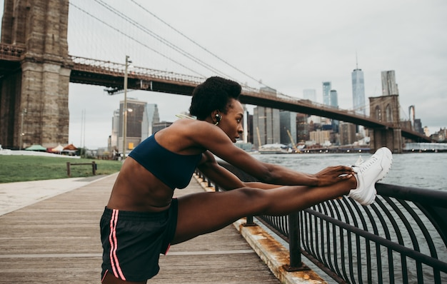 Athlete woman training in the morning at sunrise in new york city
