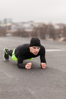 Athlete working out on rooftop