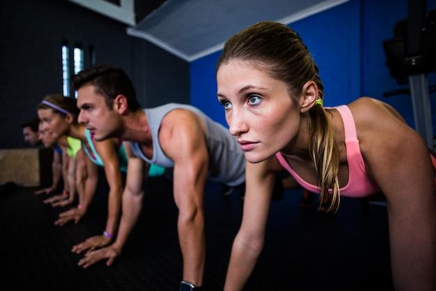 Athletes doing push-ups in gym